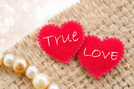 with true love: True love in red heart on sack background with beautiful bokeh.