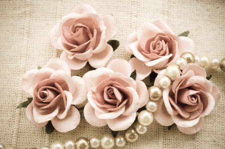 pink pearl: Vintage pink rose and Pearl Necklace on fabric background. Love concept. Stock Photo