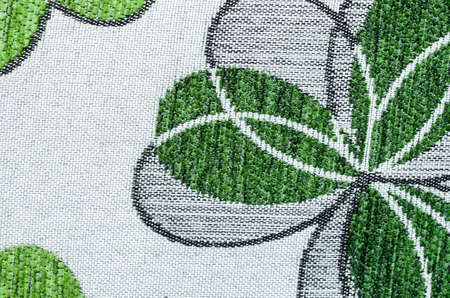 gray strip backdrop: Embroidery of green leaf on linen beige fabric can use as background.