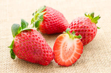 sacking: Strawberries with leaves on sacking background