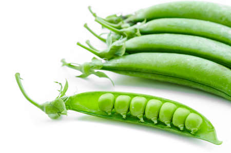 un healthy: sugar snaps peas on a white background. Stock Photo