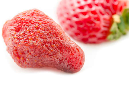 freeze dried: Close up dry strawberry with fresh strawberry on white background. Stock Photo