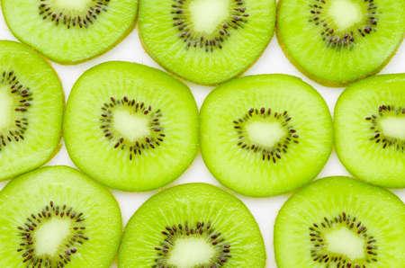 semen: Fresh organic Kiwi fruit slices on white background. Stock Photo