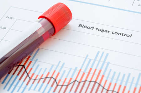 glucose: Sample blood for screening diabetic test in blood tube on blood sugar control chart. Stock Photo