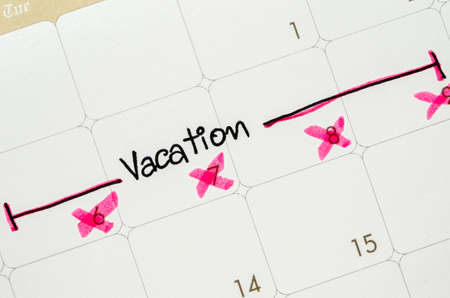 mundane: The word vacation is written on a calendar page