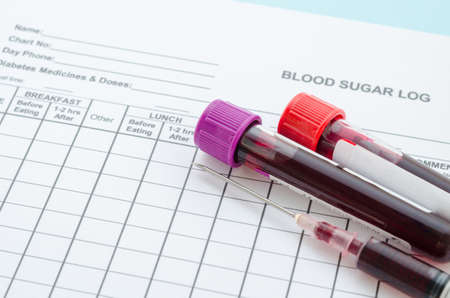 diabetes syringe: Daily blood Sugar log testing and sample blood in tube and syringe in laboratory. Blood sugar control concept. Stock Photo