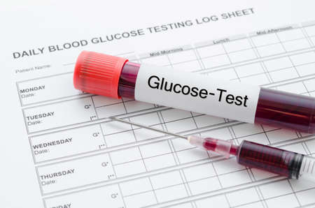 Daily blood glucose testing and sample blood in tube and syringe. Blood sugar control concept.