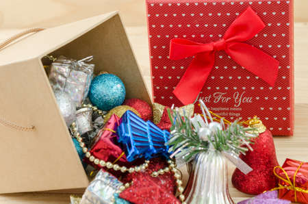 christmas ornamentation: Christmas decoration in box on wood background.