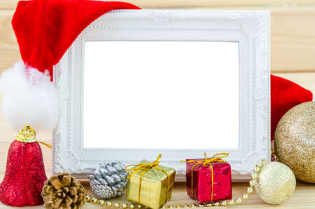 Vintage photo frame and christmas decorations on wood background. Save clipping path.