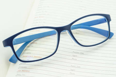 open diary: Eyeglasses on open diary planner.