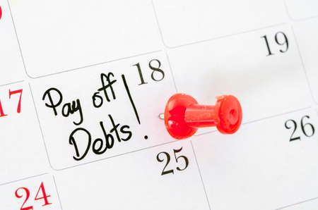 pay off: The words Pay off Debts written on a Calendar Stock Photo