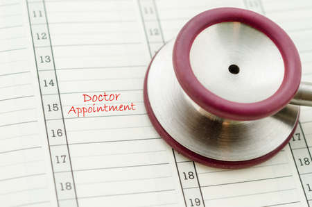 doctor's appointment: A scheduled doctors appointment is wrote on a calendar for a patient with stethoscope.