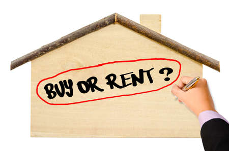 buying questions: Man Hand writing Buy or Rent? on home model isolated on white background.