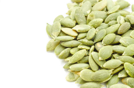 Dried Pumpkin Seeds on White Background Stock Photo