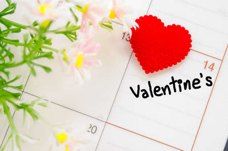 saint valentine's day: Calendar page with the red hearts on February 14 of Saint Valentines day.