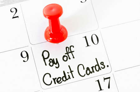 pay off: The words Pay off Credit Cards written on a Calendar. Stock Photo