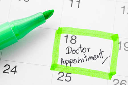 Doctor appointment on calendar. Stock Photo