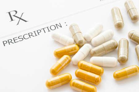prescription pad: Herb capsules on Prescription form paper.