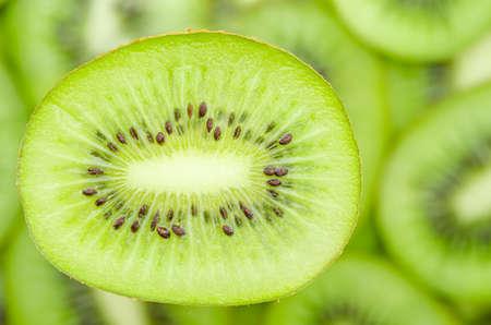 freshest: Slices of kiwi fruit on kiwi background. Stock Photo