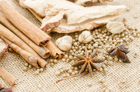 food additives: Herbs and spices selection. Aromatic ingredients and natural food additives. On sack background. Stock Photo