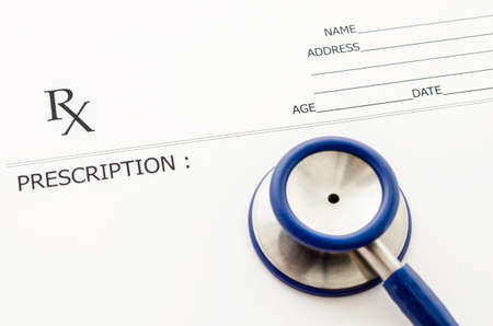rx: Closeup of a blank Rx prescription form with stethoscope .