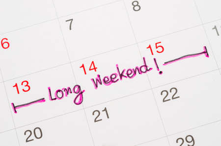 long weekend: Long weekden handwriting on page calendar to remind you an important appointment.