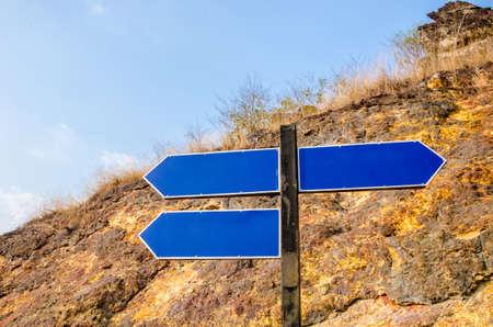 good better best: Good Better Best on blue sign road at cliff.