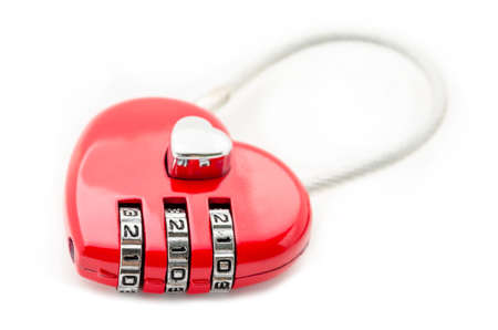 Combination lock red heart shape isolated on white background
