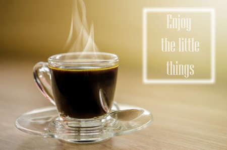 reminding: Black coffee and a note  Enjoy the little things reminding us to appreciate even the simple moments in life