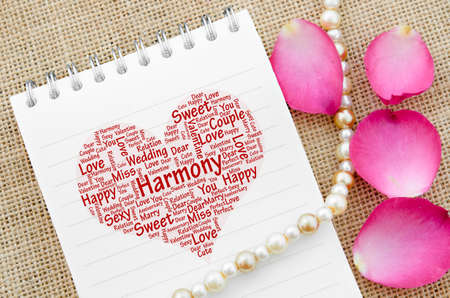 saxy: Love on open diary on with rose on sack background. Stock Photo