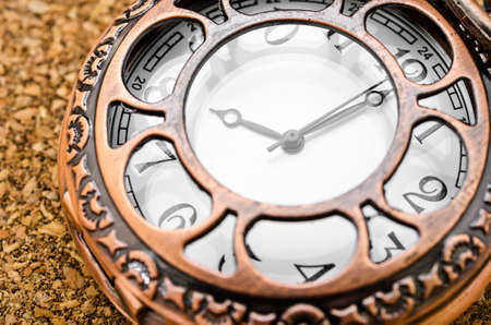 gold colour: Vintage pocket watch on wood table.