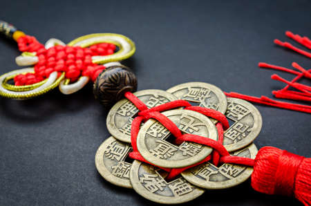 Antique Chinese coins on black background for protection and good luck Stock Photo