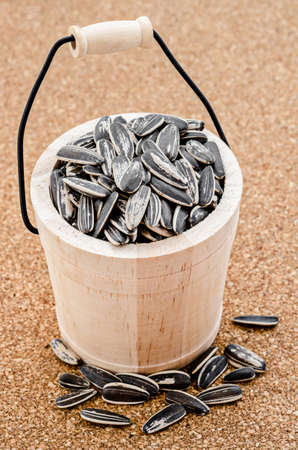 casks: Sunflower seeds in a wooden casks on table. Stock Photo