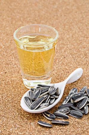 sunflower oil: Sunflower Oil with seeds on vintage wooden background Stock Photo