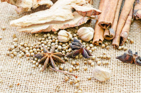 sack background: Various spices on sack background. Stock Photo