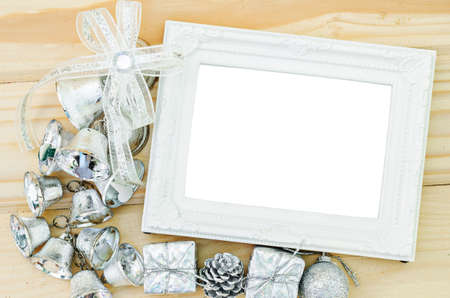 vintage photo frame: Blank vintage white photo frame with silver decoration christmas on wooden background.