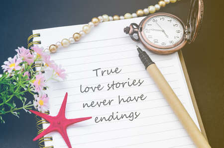 endings: True love stories never have endings handwriting on diary note with vintage pocket watch in filter.