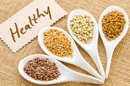 gold flax: Healthy tag with fenugreek seeds, bukwheat seeds, gold linseeds and brown linseeds.