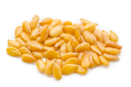 gold flax: Golden linseed or flax seeds on white background Stock Photo