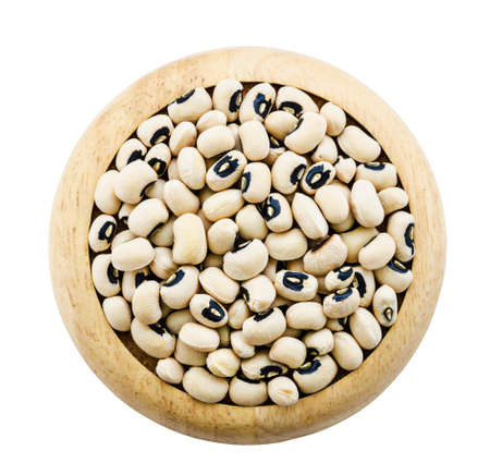 cow pea: white cow pea beans in wooden dish isolated on white background, saved clipping path.