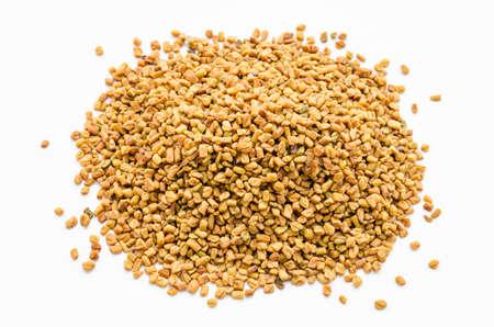 fenugreek: Fenugreek seeds spices on white background.