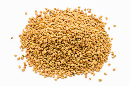 Fenugreek seeds spices on white background.