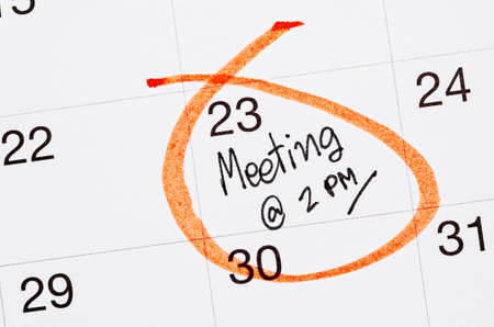 Meeting appointment written in a calendar page Stock Photo