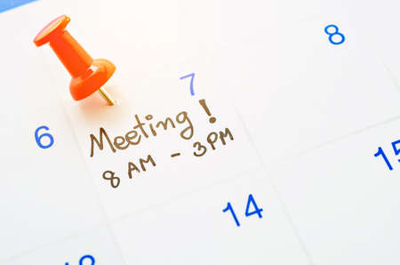 red pin: meeting day appointment with red pin push on calendar page.
