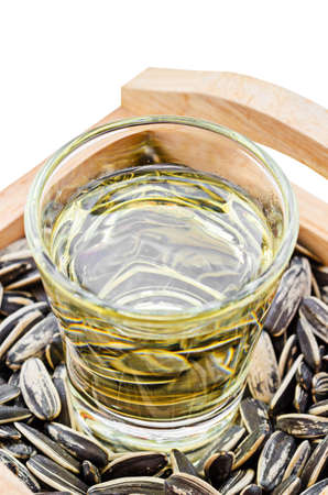 sunflower oil: Sunflower Oil with seeds on wooden Stock Photo