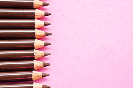 eye brow: Cosmetic brown eye brow pencil with empty space on pink background.