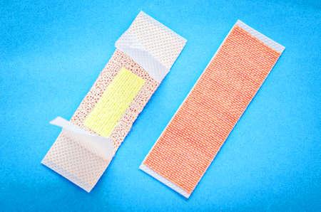 adhesive bandage: Adhesive bandage plasters set on blue background.