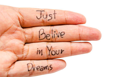 belive: Just belive in your dreams word on finger isolated on white background, Saved clipping path. Stock Photo