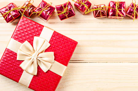 boxs: Red gift boxs christmas decorations on wooden background.