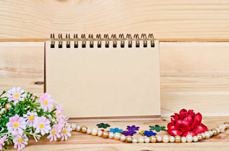 room for your text: Blank note paper for your text with flower and morning sunlight in wooden room. Stock Photo